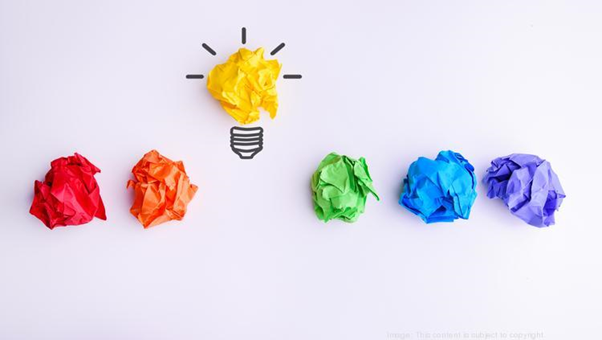 Color papers with idea lightbulb made of yellow one