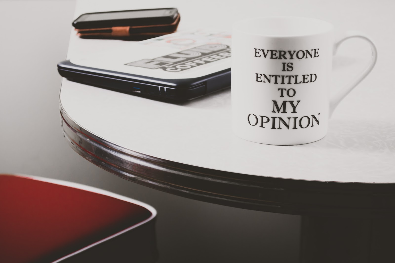 """A cup with a caption saying """"Everyone is entitled to my opinion"""""""