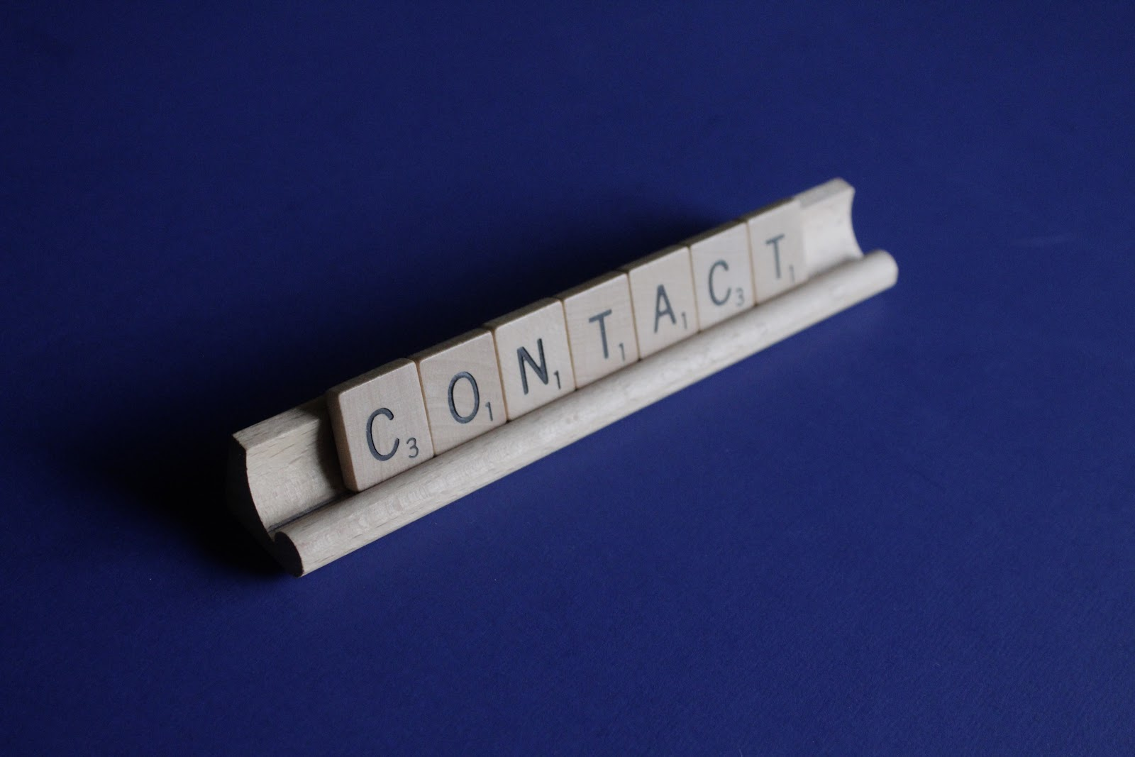 Contact made of letters from Scrabble game