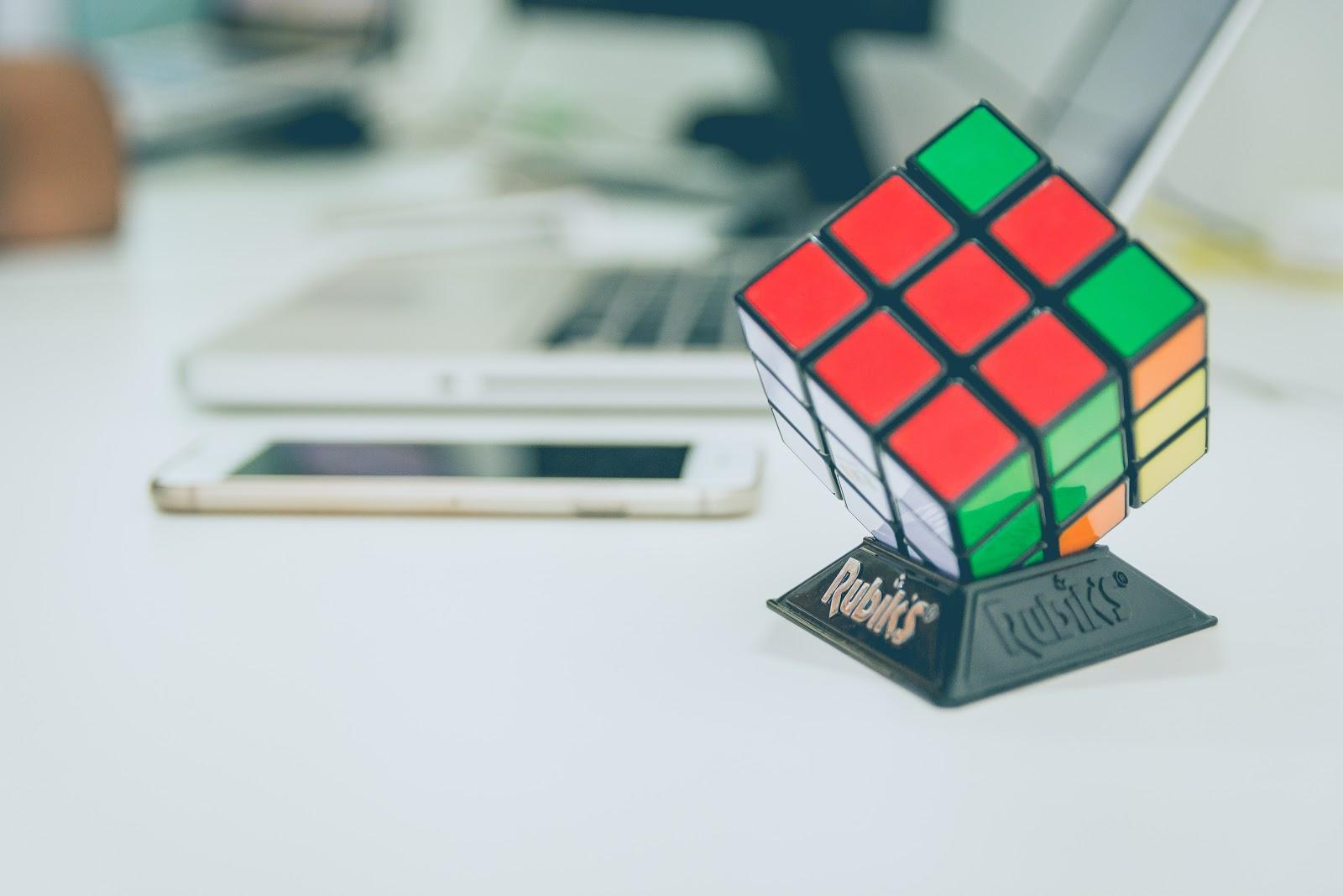 Rubik's Cube near the laptop