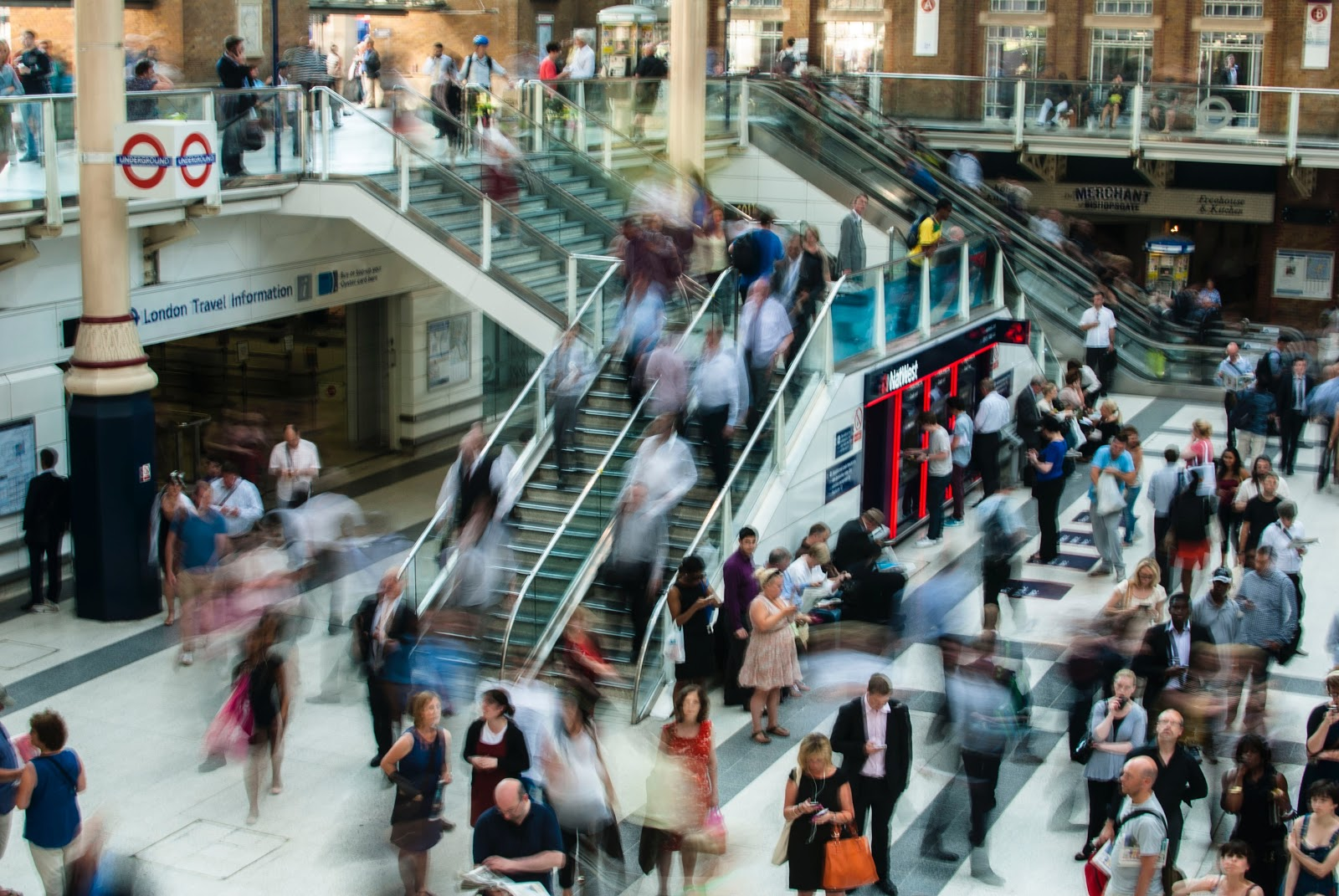People rushing in the mall