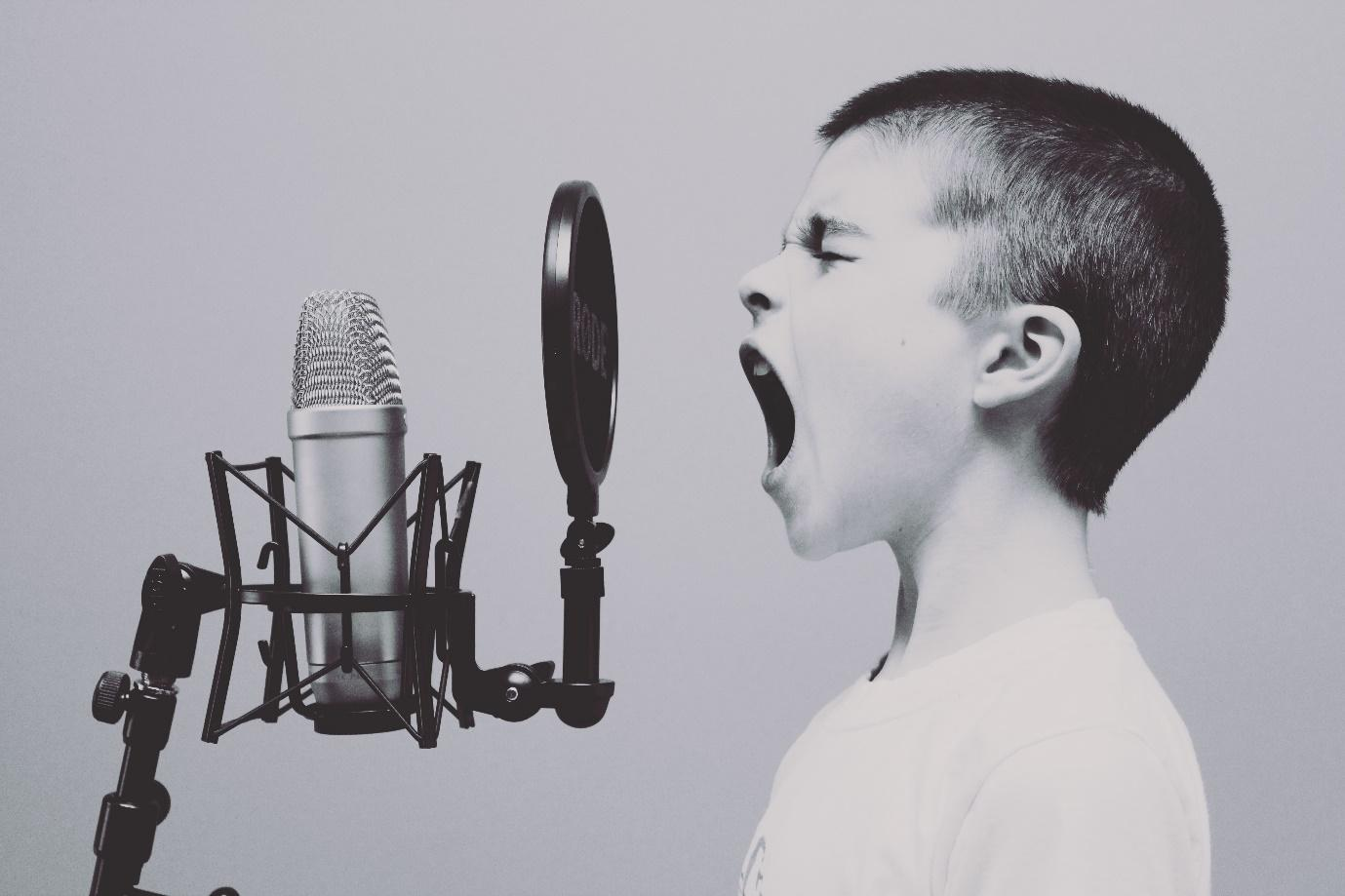 A teenager screaming into microphone