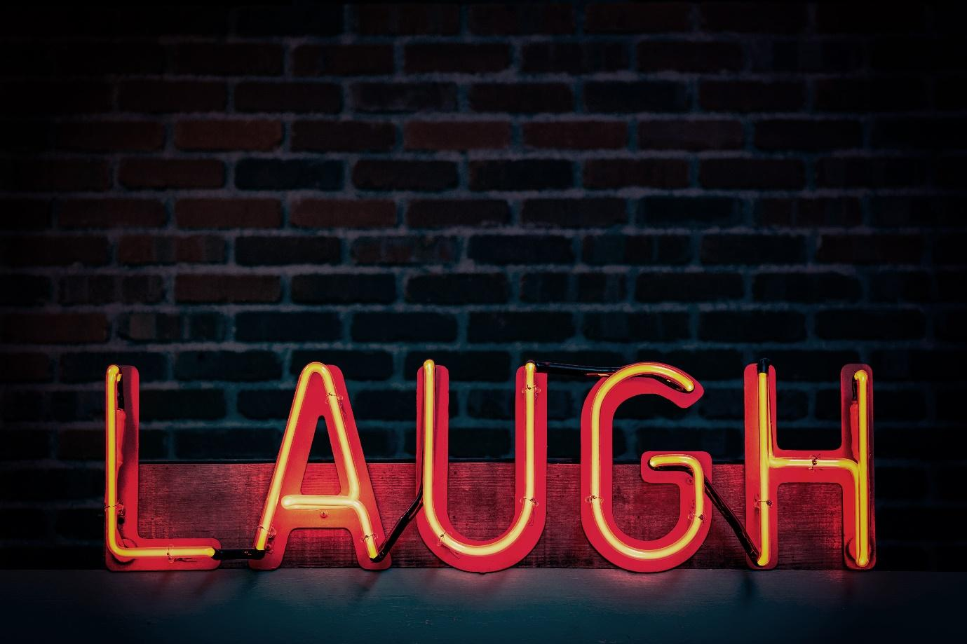 LAUGH red neon sign
