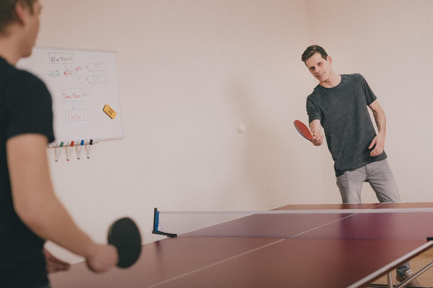 Two people playing ping-pong