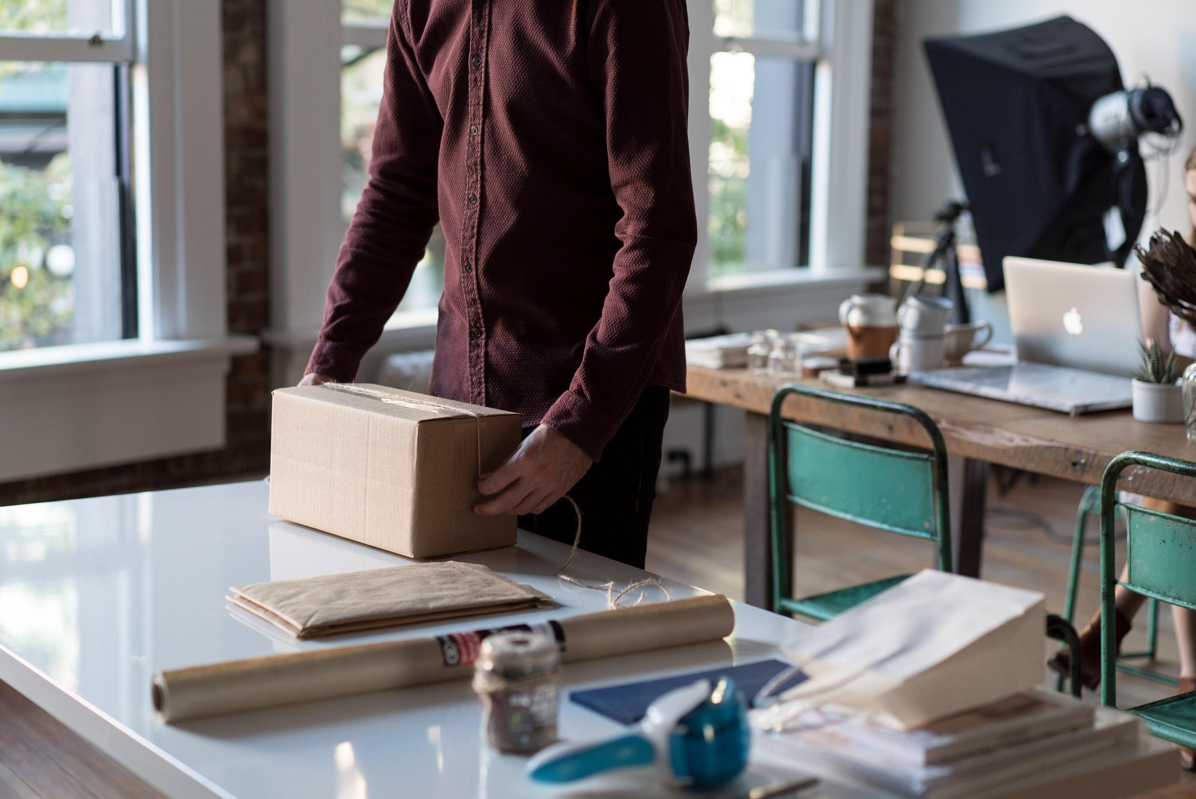 A man packing a cardboard box