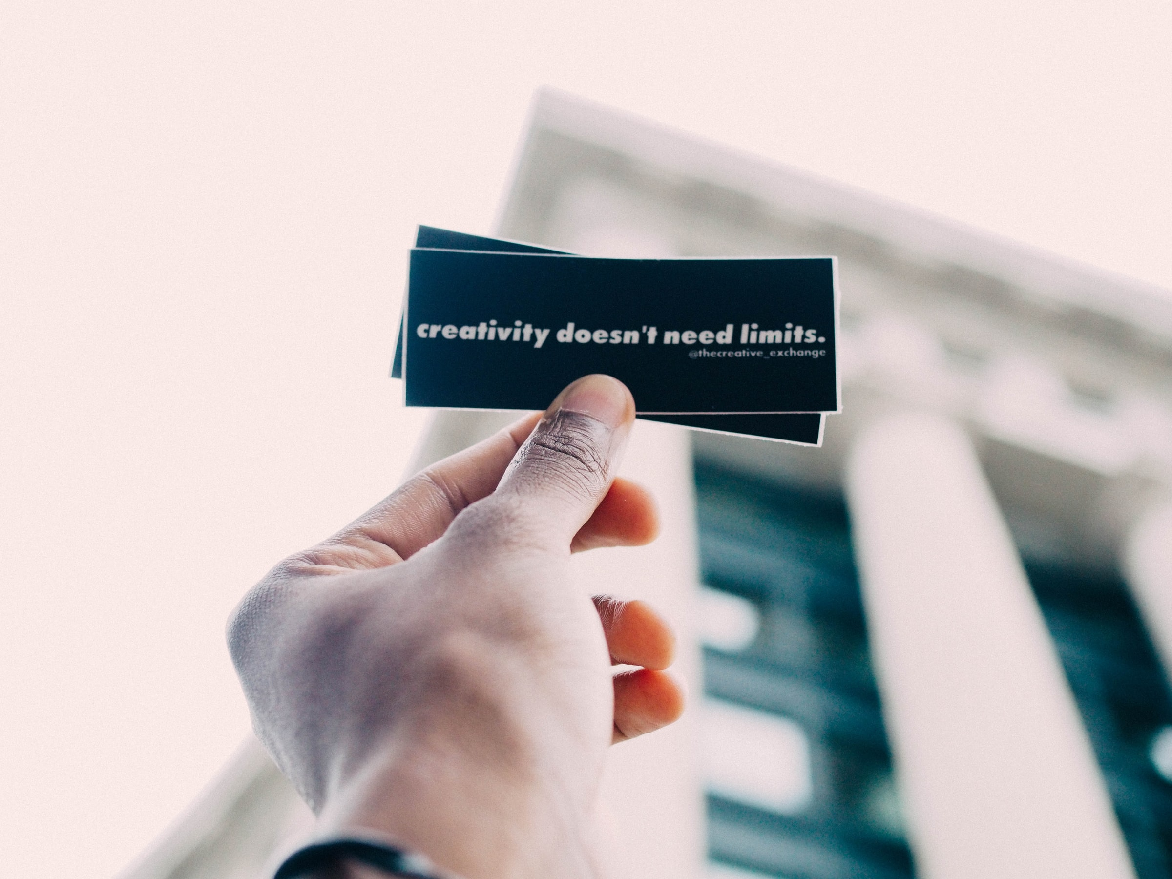 """A note with a phrase on it: """"creativity doesn't need limits""""."""