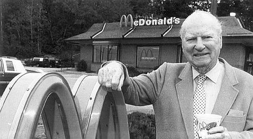 A photo of Richard McDonald beside his restaurant.