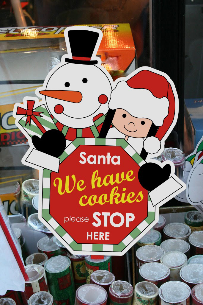 "Edited sign: ""Santa, we have cookies please stop here"""