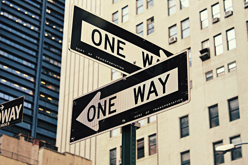 """Two """"One Way"""" street signs on the crossroad"""
