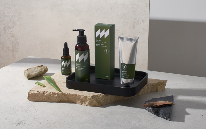 A set of grooming products in dark khaki green color