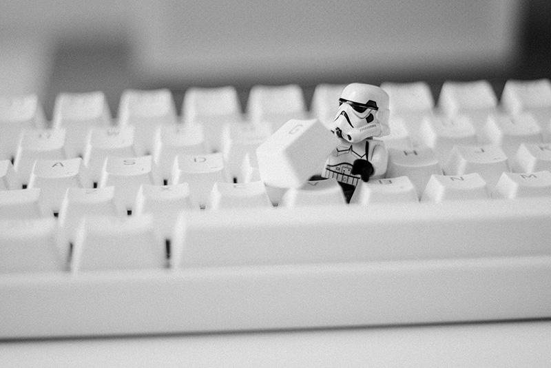 Stormtrooper hiding beneath the key of a keyboard