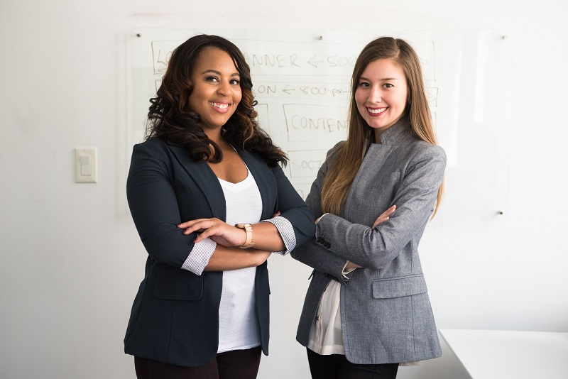 Two women after a successful business presentation