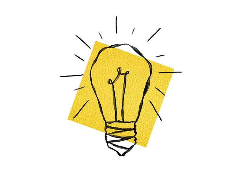 Lightbulb graphical drawing on yellow backscreen