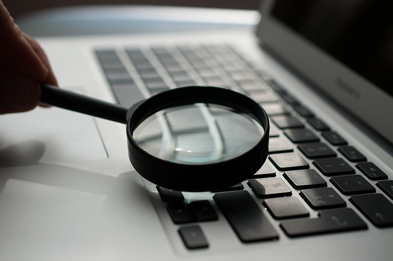 Keyboard under magnifying glass