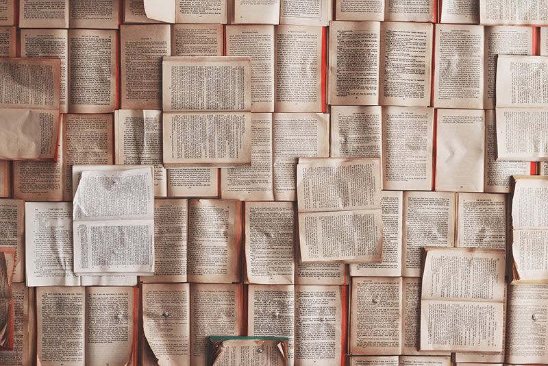 Opened books nailed to the wall