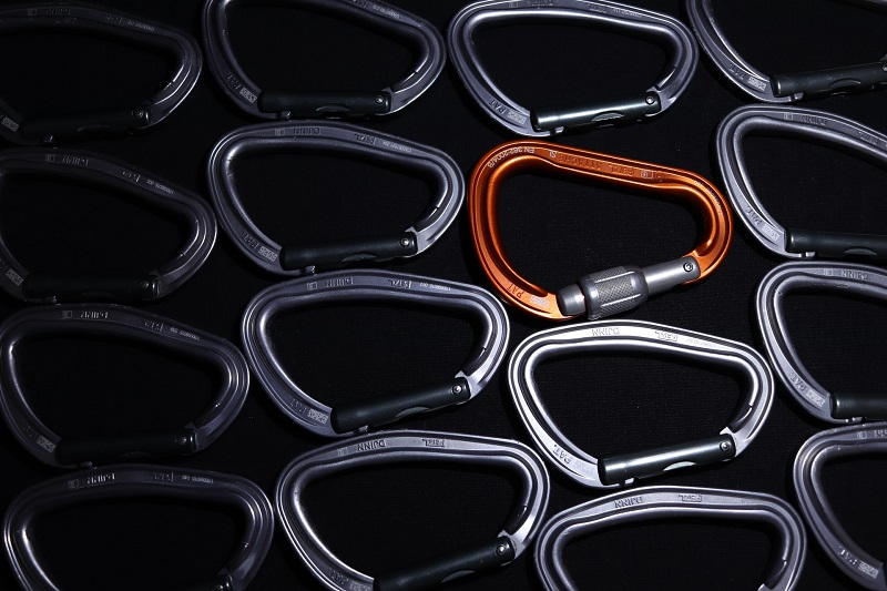 Carabiners with one of them standing out with orange color