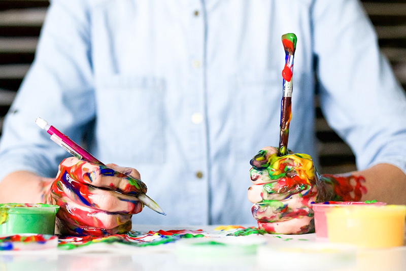 Man with paint all over his hands
